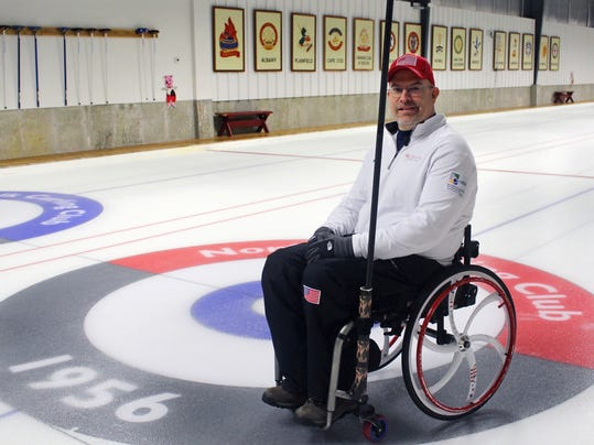 Former Connecticut basketball player Steve Emt poses at the Norfolk Curling Club in Norfolk, Conn., Wednesday, Feb. 21, 2018. Emt, who was paralyzed in a drunk driving crash in 1995, is the vice skip on the United States team that will participate in next month's Paralympic Games in South Korea. (AP Photo/Pat Eaton-Robb)