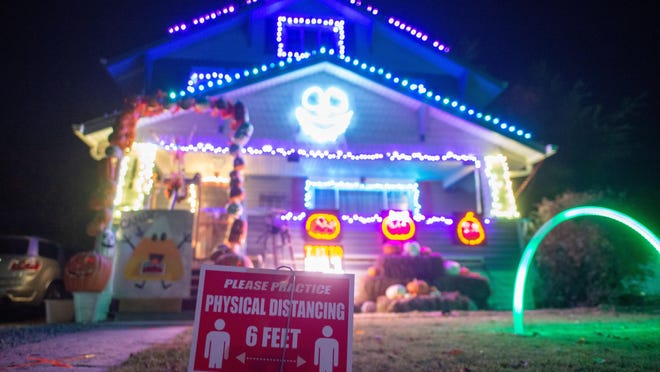 "Providing a unique and safe experience for trick-or-treaters, Shane and Bryn Reedy's house at 2838 S.E. Minnesota Ave. features flashing lights set to music, social distancing markers and a ""candy chute"" to safely give out treats to children this Halloween."