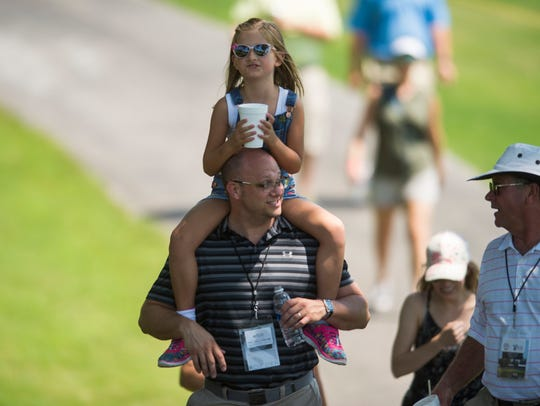 Ainsley Bettis, 6, gets a ride on her dad Richard's