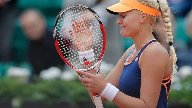 Kristina Mladenovic reacts after defeating Li Na in their first-round match at the French Open on Tuesday.