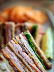 The country club at Pimentos is a mountian of a sandwich with  Holiday Ham, apple cider glazed smoked turkey, pepper bacon, swiss, cheddar, lettuce, tomato, on white or wheat. PimentoÕs Kitchen and Market on Poplar Ave. is a fresh new addition to the fast casual dining scene as the 25-year-old Memphis based Holiday Deli and Ham Co. rebrands and expands.