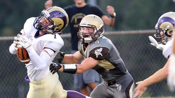Clarkstown North's Rhys Farrell-Bryan (7) intercepts the ball from Clarkstown South's Kyle Samuels (4) during game action at Clarkstown South High School in West Nyack Sept. 4, 2015.