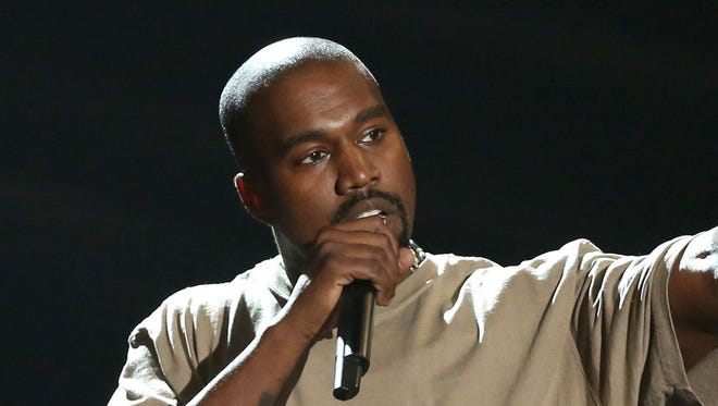 """FILE - In this Sunday, Aug. 30, 2015, file photo, Kanye West accepts the video vanguard award at the MTV Video Music Awards at the Microsoft Theater in Los Angeles. West announced on Twitter Aug. 17, 2016, that he will open 21 temporary """"Pablo"""" stores worldwide on the weekend of Aug. 20. (Photo by Matt Sayles/Invision/AP, File) ORG XMIT: PAPM102"""