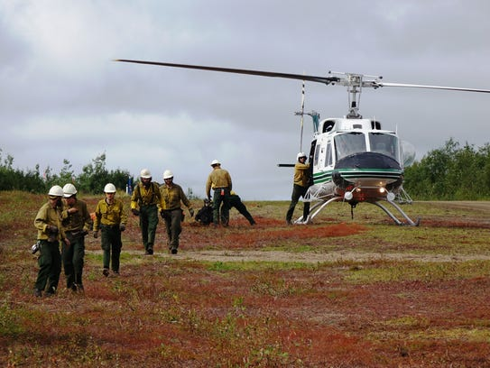 Wildland firefighters returning from an extended deployment