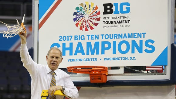 Michigan Wolverines head coach John Beilein celebrates