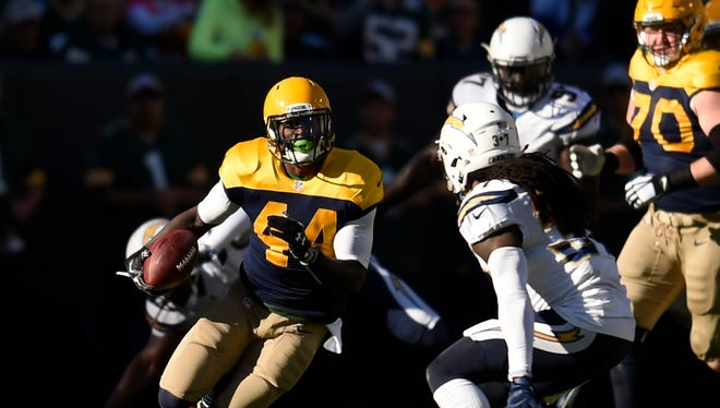 Green Bay Packers running back James Starks (44) runs the ball in the first quarter against the San Diego Chargers at Lambeau Field.