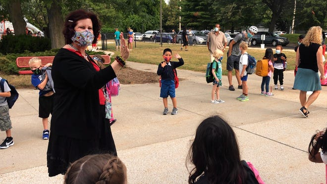 Holland West Elementary principal Kathleen Ramirez greets students Wednesday, Aug. 26, on the first back in the classroom for Holland Public Schools. The district has scheduled a series of town hall meetings to discuss the beginning of the year.