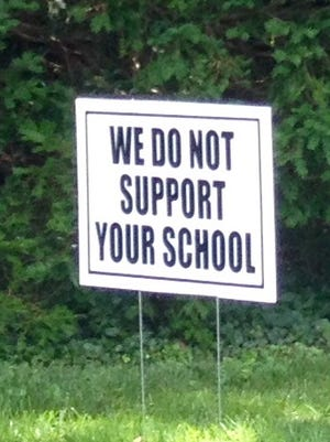 Alta Vista Road, where Stonecote Sudbury School is planned, is lined  with signs opposing the school.