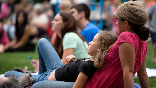 Concert goers watch Danielle Ate the Sandwich perform during the Lagoon Concert Series on Colorado State University campus in Fort Collins Wednesday, July 9, 2014.