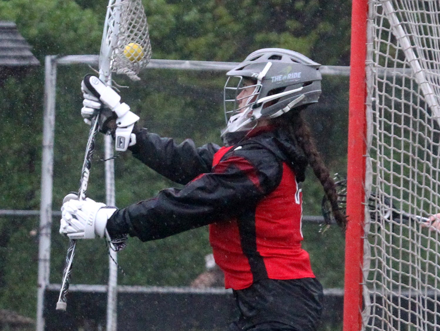 Rye's Michella Dinardo makes a save during Rye's10-9 win at Scarsdale May 13, 2016.