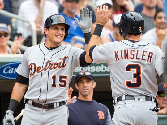 Tigers outfielder Mikie Mahtook (15) congratulates