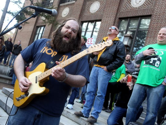 Laith Al-Saadi is a longtime fixture on the Detroit-Ann Arbor music scene. Here he's pictured playing the national anthem at the 2014 Hash Bash on the University of Michigan campus. Eric Seals/Detroit Free Press