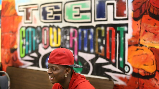 Freemonta Strong takes part in a Teen Empowerment group meeting.  The group offers employment for some in the Genesee Street neighborhood near the Boys & Girls Club.