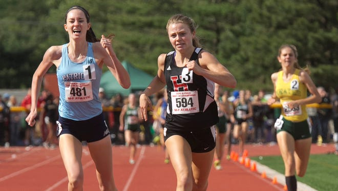 Haddonfield's Briana Gess, center, holds off a late charge by Freehold Township's Ciara Roche, left, to win her third 1,600-meter title at Wednesday's Meet of the Champions.