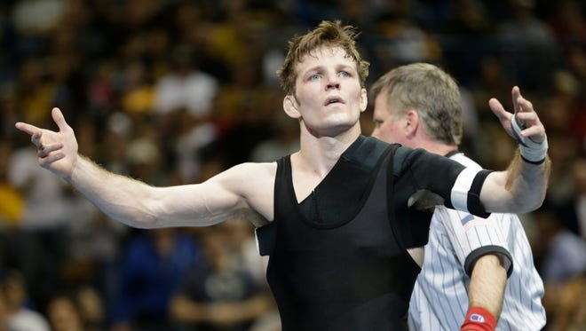 Iowa's Cory Clark celebrates after defeating South Dakota States Seth Gross in the 133-pound final at the NCAA Division I wresting championships on Saturday in St. Louis.