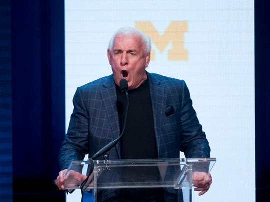 "Pro wrestler Ric Flair does his signature ""Woo!"" as he gives a speech during the event."