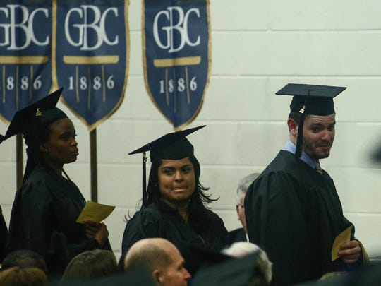 Goldey-Beacom College candidates for graduation Daniel Alex Brennan, right, waits to receive his Master of Business Administration Degree.