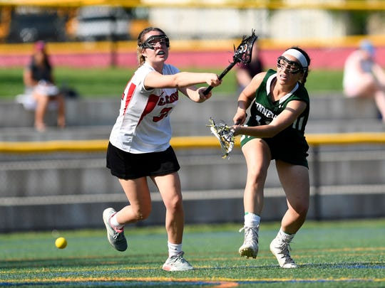 Kinnelon's Katie Bonanno, right, takes a shot on goal. Glen Rock defeats Kinnelon 15-7 in the North 1, Group 1 quarterfinals on Thursday, May 18, 2017.
