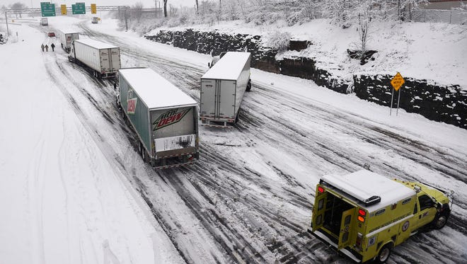 The west bound lanes of I-40 coming into town are closed as trucks are stuck Friday morning and the area gets covered in snow Jan. 22, 2016 in Nashville, Tenn.