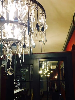 A chandelier at the new Moxie Food + Drink, 501 E. Silver Spring Drive in Whitefish Bay, incorporates forks, knives and spoons.