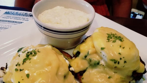 Sailfish Cafe's eggs Benedict Florentine ($9.50) is a toasted English muffin topped with two perfectly poached eggs on a bed of spinach tomato and feta cheese topped with Hollandaise.
