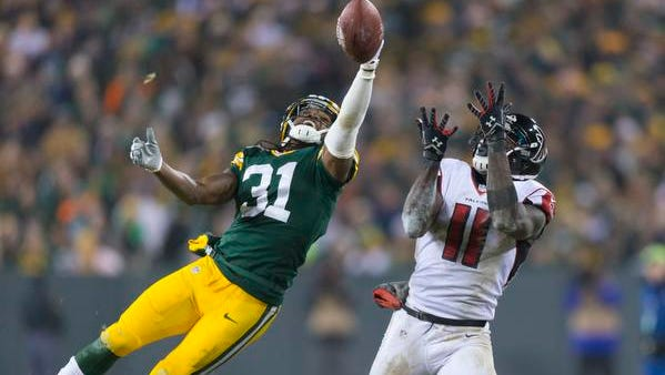 Green Bay Packers cornerback Davon House (31) breaks up the pass intended for Atlanta Falcons wide receiver Julio Jones (11) during the fourth quarter at Lambeau Field.  Green Bay won 43-37.