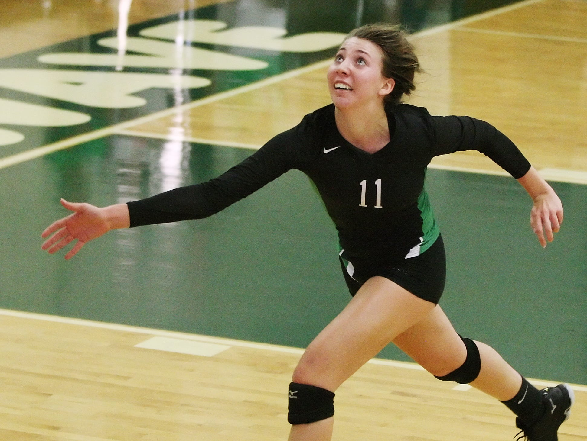 Fort Myers High School's Alayna Ryan hustles to keep the ball in play in the Region 6A-3 semifinal volleyball game Saturday at Fort Myers High School. Fort Myers beat Barron Collier 3-0.