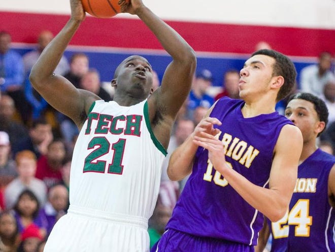 Tech's Demetrius Shaw works against Marion's Xavier Aguilar.