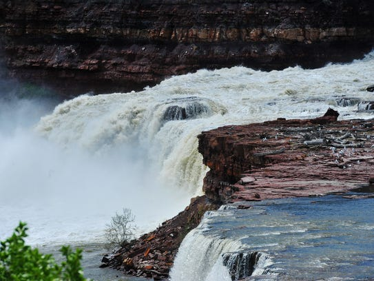The Missouri River races over Rainbow Falls below Rainbow