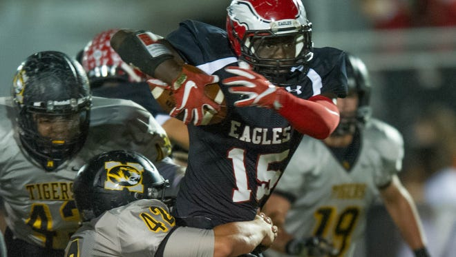 Florence's Degerrick Lee tries to break a tackle from Northeast Jones' Curt Parker in the Eagles' first-round playoff win.