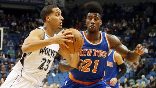 Minnesota's Kevin Martin, left, drives around the Knicks' Iman Shumpert in the first quarter on Wednesday, in Minneapolis.