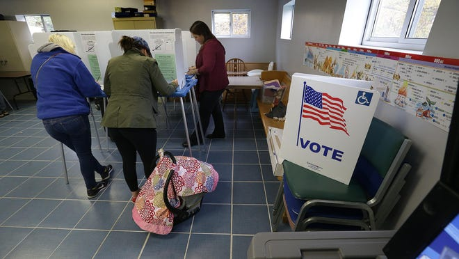 Voters mark their choices on their ballots while voting at the Arlington Avenue Baptist Church during election day Tuesday, November 8, 2016, afternoon in Marion County.