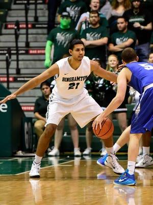 Binghamton University forward Nick Madray plays defense against Hartwick College in November.
