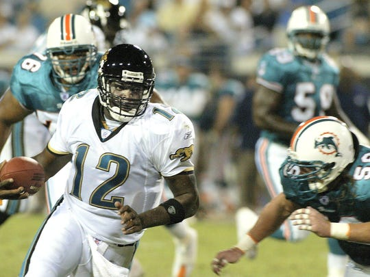 Jacksonville Jaguars quarterback Quinn Gray scrambles for a gain during a game against the Miami Dolphins.