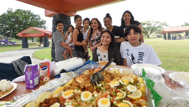 Members of the Montevirgen, Lopez, and Enriquez families celebrate Christmas Day at the Governor Joseph Flores Memorial Park in Tumon Dec. 25, 2017.
