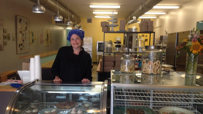 Jana Douglass behind the counter at Happy Chicks Bakery in Northside.