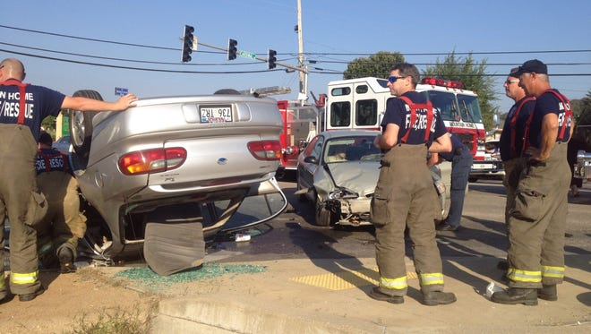 Emergency personnel respond to a two-vehicle accident Tuesday morning at the corner of U.S. Highway 62 East and Cardinal Drive.