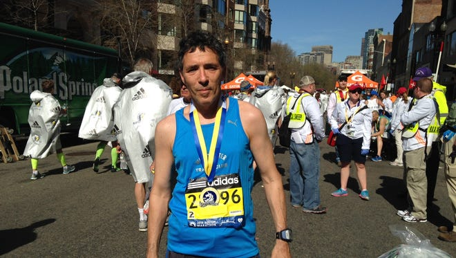 Visual Journalist and lohud.com photographer Seth Harrison is photographed April 21, 2014 following his 4:05:01 run in the 118th Boston Marathon.