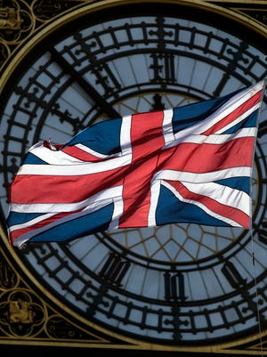 A time ticks away to the day of Article 50 and Brexit, the Union flag flutters in front of the clock face of Big Ben, formally known as the Elizabeth Tower of the Houses of Parliament in Westminster, central London, March 9, 2017.