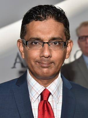 "LOS ANGELES, CA - JUNE 30:  Writer/director Dinesh D'Souza attends the premiere of Lionsgate Films' ""America"" at Regal Cinemas L.A. Live on June 30, 2014 in Los Angeles, California.  (Photo by Alberto E. Rodriguez/Getty Images) ORG XMIT: 499374135 ORIG FILE ID: 451536086"