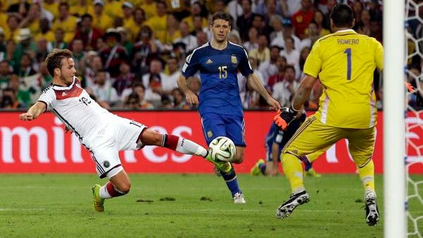 Germany's Mario Goetze kicks the ball past Argentina goalkeeper Sergio Romero during the second period of extra time to score the only goal in the World Cup final Sunday in Rio de Janeiro. Germany became the first European team to win a World Cup in the Americas.