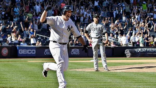 Brian McCann exults while running down the first-base line after hitting a three-run homer off White Sox relief pitcher Jake Petricka, right, in the 10th inning on Sunday. The Yankees won, 7-4.