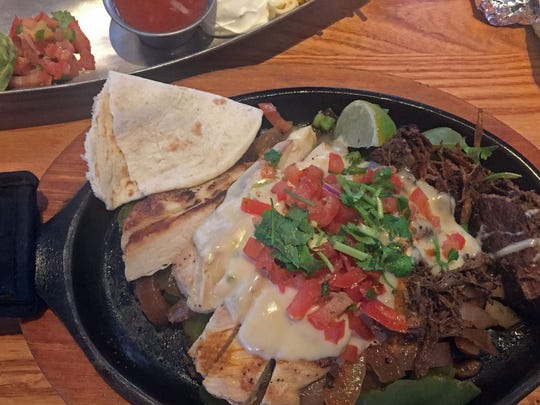 Mixed fajitas: chicken and carnitas with all the fixings