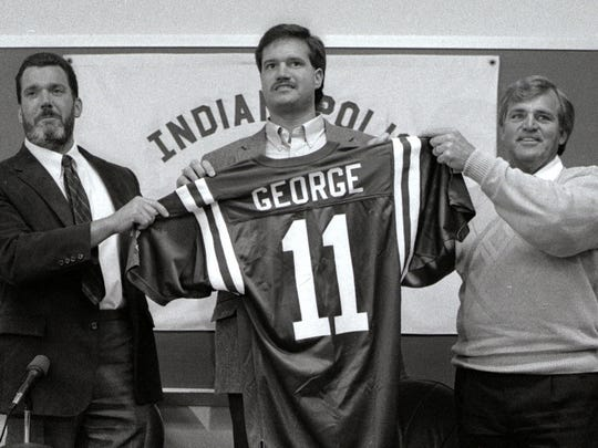 Jim Irsay (left) introduces Jeff George after he signed with the Indianapolis Colts, April 20, 1990.  Coach Ron Meyer is on the right.