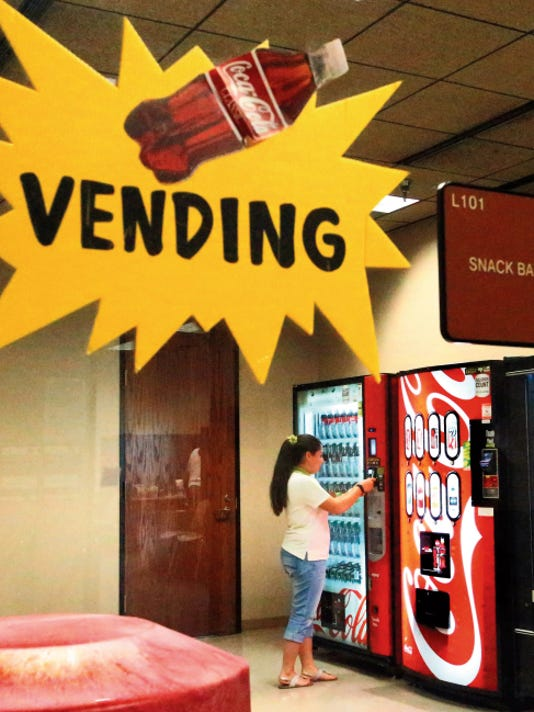 Rudy Gutierrez—El Paso Times The vending machines in the basement of the County Courthouse offer mostly sodas, tea and water.