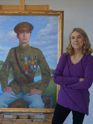 Salem artist April Waters with her completed portrait of Oregon Medal of Honor recipient Edward Allworth. The portrait was commissioned by Oregon's Percent for Art Program and the Oregon Department of Veterans' Affairs.