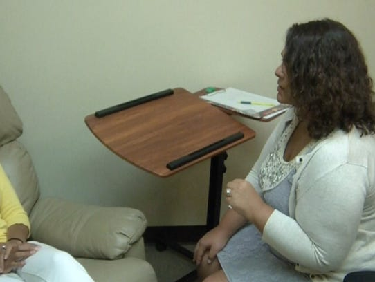 Traci Blank demonstrating hypnotherapy.