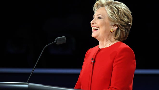 Hillary Clinton speaks on stage during the first presidential debate at Hofstra University, in New York Sept. 226, 2016.