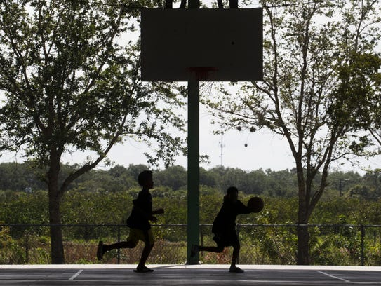 """Kids play basketball at the Charleston Park courts on Charleston Park Day in 2017. """"Residents worry the well water is detrimental to the health of their kids,"""" said Tim Byrne, CEO of Aqua Consultants."""