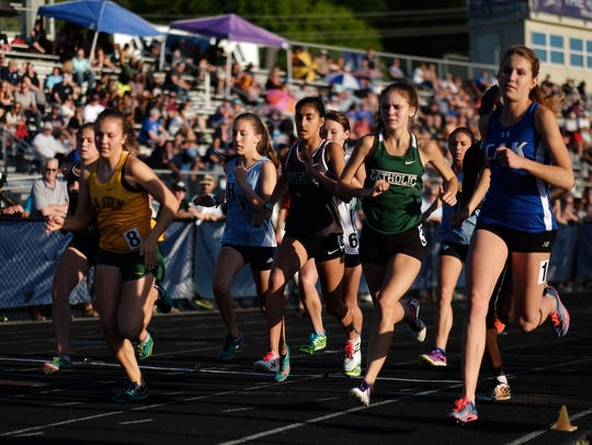 Runners compete in the girl's 1600 meter race during